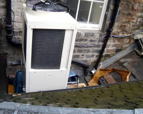 air conditioning unit on roof with fan